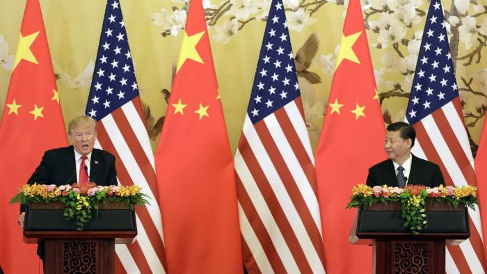 U.S. President Donald Trump, left, speaks as Xi Jinping, China's president, looks on during a news conference at the Great Hall of the People in Beijing, China, on Thursday, Nov. 9, 2017. Trumpsaid China is taking advantage of American workers and American companies with unfair trade practices, but he blamed his predecessors in the White House rather than China for allowing the massive U.S. trade deficit to grow. Photographer: Qilai Shen/Bloomberg