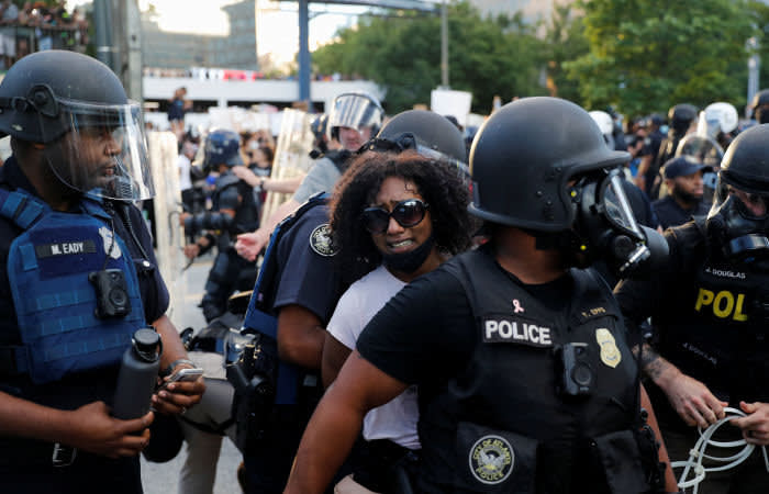 A protester is detained by police officers during a protest against the death in Minneapolis police custody of George Floyd, in Atlanta, U.S., May 30, 2020. REUTERS/Shannon Stapleton - RC2CZG9YAWQP