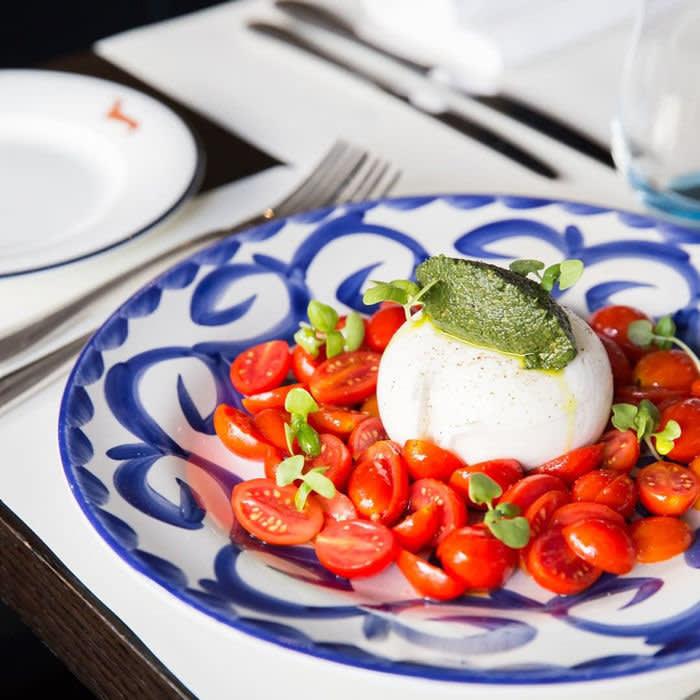 Margot restaurant, Lodnon Pugliese burrata with datterini tomatoes, basil and spinach pesto