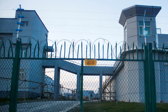 A 'vocational skills education centre' in Dabancheng, Xinjiang, still under construction in this picture from September last year, with high barbed wire walls and guard towers