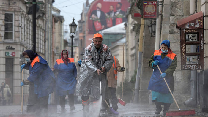 Mandatory Credit: Photo by MARKIIAN LYSEIKO/EPA-EFE/Shutterstock (10589085c) Communal workers clean and disinfect a street in the Western-Ukrainian city of Lviv, Ukraine, 20 March 2020. Due to the ongoing pandemic of the COVID-19 disease caused by the SARS-CoV-2 coronavirus, all shops and catering facilities are closed in the country since 17 March. All trips between the city of Kiev and other parts of Ukraine are limited. Cultural, sporting, social, religious and other events implying mass attendance have been suspended. Supermarkets, pharmacies and gas stations will remain open. Ukraine announced nationwide quarantine measures over coronavirus pandemic, Lviv - 20 Mar 2020