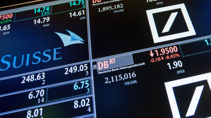A monitor displays signage for Deutsche Bank AG, Credit Suisse Group AG, and Citadel Securities LLC on the floor of the New York Stock Exchange (NYSE) in New York, U.S., on Monday, March 27, 2017. U.S. stocks fell, extending a decline on Friday after President Trump failed to pass his health-care bill, undermining optimism he can enact growth policies that invigorated bulls after the election. Photographer: Michael Nagle/Bloomberg