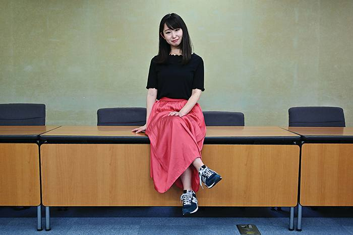 Yumi Ishikawa, leader and founder of the KuToo movement, poses after a press conference in Tokyo on June 3, 2019. - A group of Japanese women on June 3 submitted a petition to the government to protest what they say is a de-facto requirement for female staff to wear high heels at work. The online campaign #KuToo, using a pun from a Japanese word