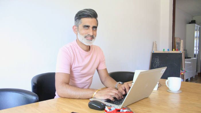 Ganeev Chadha is commercial performance manager at professional services firm EY and has profound hearing loss. He uses subtitles on video calls while working from home to counter is disability.