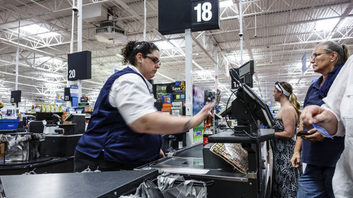A cashier in Walmart. (Photo by: Jeffrey Greenberg/Universal Images Group via Getty Images)