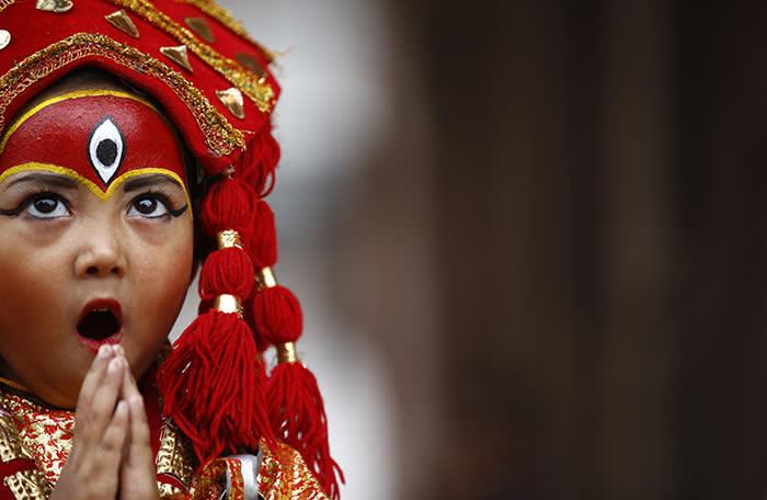 dpatop - 22 September 2018, Nepal, Kathmandu: A girl adorned as a Living Goddess takes part in the Kumari Puja rituals in Kathmandu, Nepal, 22 September 2018. Photo: Skanda Gautam/ZUMA Wire/dpa