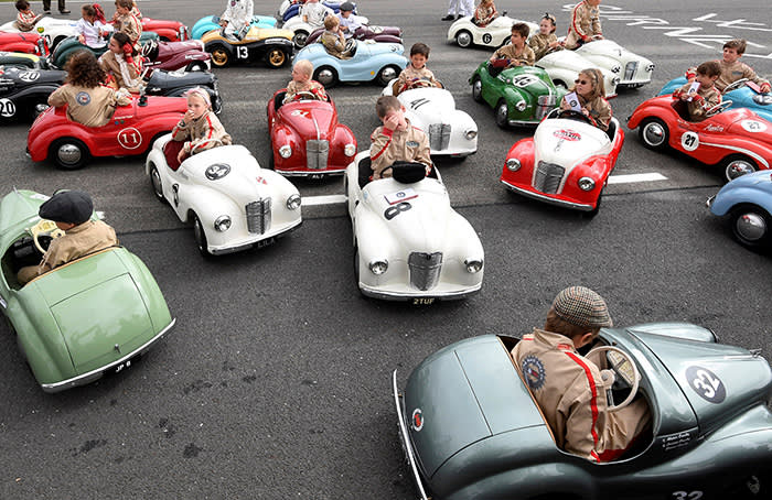 Children react after competing in a pedal car race as motoring enthusiasts attend the Goodwood Revival, a three day classic car racing festival celebrating the mid-twentieth century heyday of the sport, at Goodwood in southern Britain, September 9, 2018. REUTERS/Toby Melville TPX IMAGES OF THE DAY