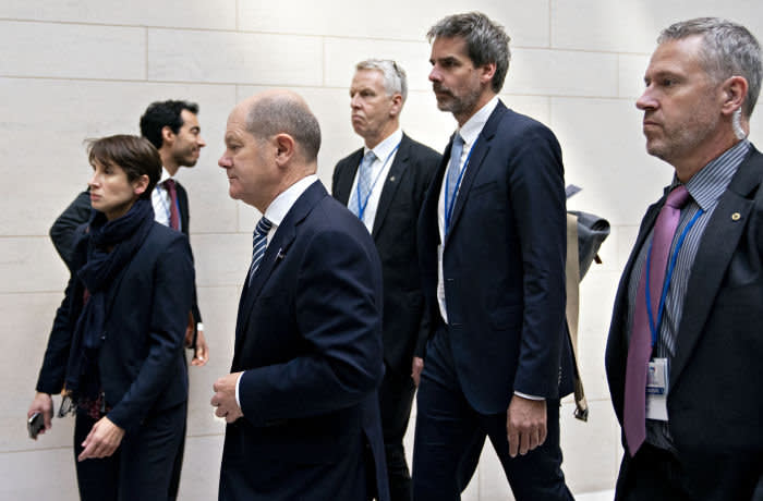 Olaf Scholz, Germany's finance minister, second left, exits after a Group of 20 (G-20) and finance ministers and central bank governors meeting on the sidelines of the annual meetings of the International Monetary Fund (IMF) and World Bank Group in Washington, D.C., U.S., on Friday, Oct. 18, 2019. The IMF made a fifth-straight cut to its 2019 global growth forecast, citing a broad deceleration across the world's largest economies as trade tensions undermine the expansion. Photographer: Andrew Harrer/Bloomberg