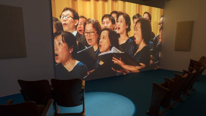 Samson Young's video installation 'We Are the World, as performed by the Hong Kong Federation of Trade Unions Choir' (2017)