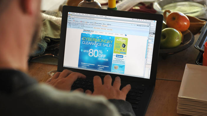 A man looks at a Cyber Monday advertisement on his laptop computer in Los Angeles on November 30, 2009. AFP PHOTO/Robyn Beck (Photo credit should read ROBYN BECK/AFP via Getty Images)