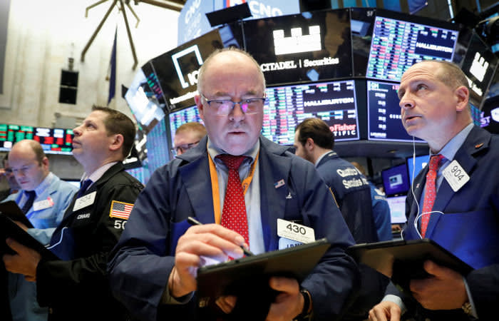 Traders work on the floor at the New York Stock Exchange (NYSE) in New York, U.S., February 25, 2020. REUTERS/Brendan McDermid