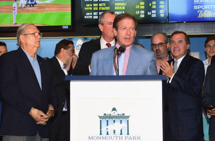 OCEANPORT, NJ - JUNE 14: Chairman and CEO of Darby Development / Operator of Monmouth Park Dennis Drazin speaks during the William Hill Sports Book at Monmouth Park as it opens and welcomes public to place first legal sports bets on June 14, 2018 in Oceanport, New Jersey. (Photo by Dave Kotinsky/Getty Images for William Hill Race & Sports Bar )