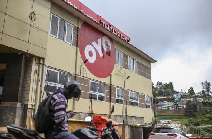The logo of OYO Rooms, operated by Oravel Stays Pvt, is displayed outside a hotel in Ooty, Tamil Nadu, India, on Friday, June 8, 2018. Most Asian markets were in the red on June 18 as concern that the row between U.S. and China may turn into a full-blown trade war. Most Asian markets were in the red on June 18 as concern that the row between U.S. and China may turn into a full-blown trade war. Photographer: Dhiraj Singh/Bloomberg