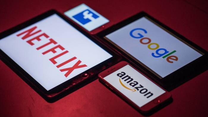 The logos for Facebook Inc., Amazon.com Inc., Netflix Inc. and Google, a unit of Alphabet Inc., sit on smartphone and tablet devices in this arranged photograph in London, U.K., on Monday, Aug. 20, 2018. The NYSE FANG+ Index is an equal-dollar weighted index designed to represent a segment of the technology and consumer discretionary sectors consisting of highly-traded growth stocks of technology and tech-enabled companies. Photographer: Jason Alden/Bloomberg