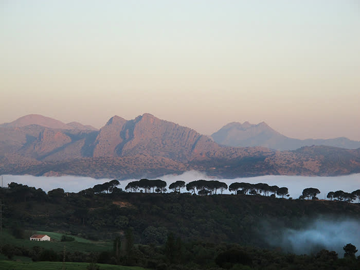 Dawn view from Ronda towards Benaojan and the Sierra Grazalema - the first stage of the walk. credit Stephen Venables