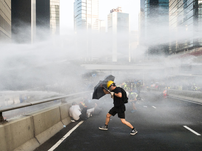 Demonstrators, some not yet teenagers, battle water cannon, tear gas and even gunfire, often with just umbrellas and hard hats for protection