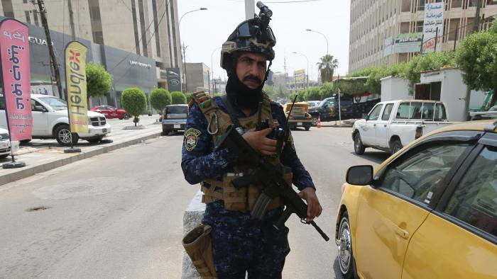 A member of the Iraqi federal police forces stands guard at a checkpoint in Baghdad's Karada district on May 20, 2019. - A Katyusha rocket crashed the previous day into Baghdad's Green Zone which houses government offices and embassies including the US mission, Iraqi security services said in a statement. The rocket -- which came after Washington ordered the evacuation of non-essential diplomatic staff from the Baghdad embassy and the Arbil consulate citing threats from Iranian-backed Iraqi armed groups -- caused no casualties, it said. (Photo by AHMAD AL-RUBAYE / AFP) (Photo credit should read AHMAD AL-RUBAYE/AFP/Getty Images)