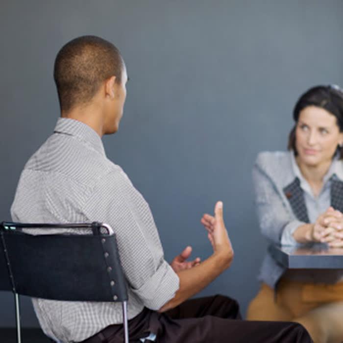 Businessman talking to co-worker in office