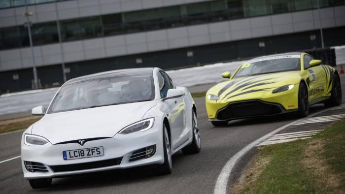 Tesla Model S races against Aston Martin Vantage at Silverstone race circuit on August 8, 2018.
