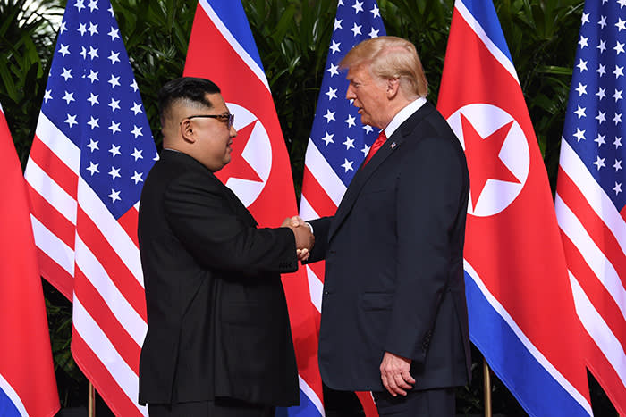 TOPSHOT - North Korea's leader Kim Jong Un (L) shakes hands with US President Donald Trump (R) at the start of their historic US-North Korea summit, at the Capella Hotel on Sentosa island in Singapore on June 12, 2018. - Donald Trump and Kim Jong Un have become on June 12 the first sitting US and North Korean leaders to meet, shake hands and negotiate to end a decades-old nuclear stand-off. (Photo by SAUL LOEB / AFP) (Photo credit should read SAUL LOEB/AFP/Getty Images)