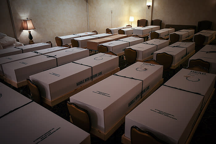 Coffins of people who have died from Covid-19 lined up in a funeral home in Queens, New York. Recent estimates suggest 135,000 people will die by late July