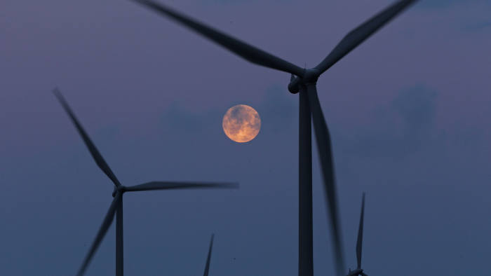 GLASGOW, SCOTLAND - OCTOBER 07: The moon rises behind the turbines of Whitelees Windfarm on October 7, 2014 in Glasgow, Scotland. Whitelee Wind farm is the largest windfarm in the UK. (Photo by Christopher Furlong/Getty Images)