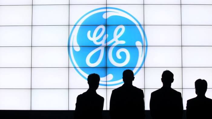 The General Electric Co. (GE) logo is displayed during the opening of the company's iCenter facility in Kuala Lumpur, Malaysia, on Tuesday, Oct. 21, 2014. GE surged the most in a year after beating analysts' profit estimates as Chief Executive Officer Jeffrey Immelt squeezes more costs from the manufacturing units. Photographer: Goh Seng Chong/Bloomberg