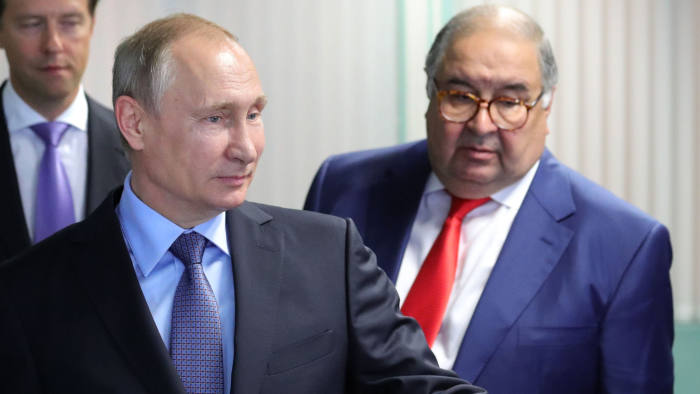 Russian President Vladimir Putin (L) and founder of USM Holdings Alisher Usmanov (R) look on at the control center of the new workshop producing hot briquetted iron at Lebedinsky Mining and Processing Combine (Metalloinvest MC LLC) in the Belgorod Region on July 14, 2017. / AFP PHOTO / Sputnik / Michael Klimentyev (Photo credit should read MICHAEL KLIMENTYEV/AFP via Getty Images)