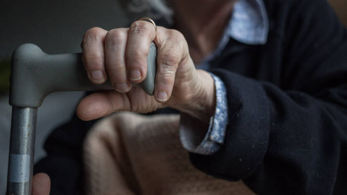 BRISTOL, ENGLAND - FEBRUARY 16: In this photo illustration an elderly person sits in a chair at home on February 16, 2015 near Bristol, England. The issues affecting the elderly, along with education and the economy are likely to be key elections issues in the forthcoming general election in May. (Photo by Matt Cardy/Getty Images)