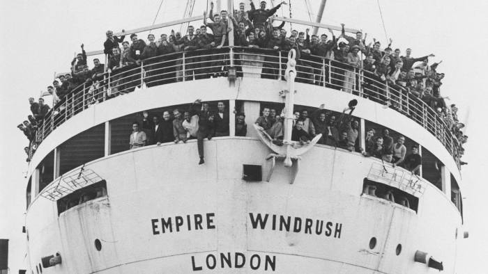 Jamaican immigrants arriving at Tibury Docks in Essex, 22 June 1948.'The former troop ship 'Empire Windrush' arrived at Tilbury Docks this morning with 450 Jamaicans, mostly Royal Air Force ex-servicemen, aboard. They have come to Britain to escape their island's unemployment problem. Until they are absorbed into British industry, some of the men will be accomodated at the Colonial Hostel in Wimpole Street in London, whilst others will be staying in the deep air raid shelters on Clapham Common. Some of the immigrants on board the Empire Windrush.' Photograph by Jones. (Photo by Daily Herald Archive/SSPL/Getty Images)