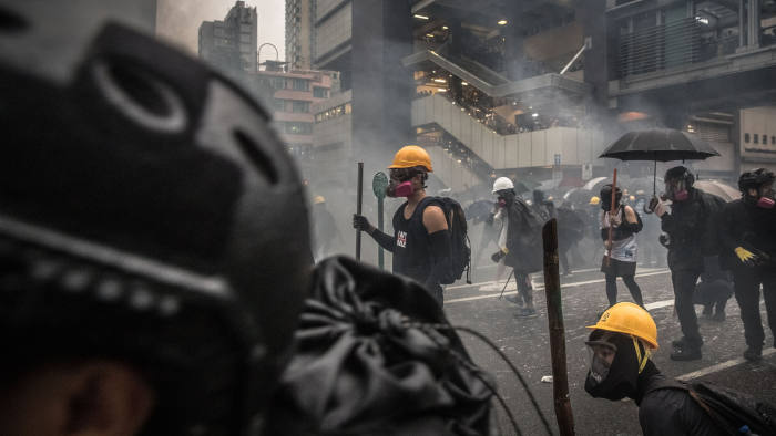 Mandatory Credit: Photo by ROMAN PILIPEY/EPA-EFE/Shutterstock (10371693z) Protesters wearing gas masks in action agains the police during an anti-government rally in Tsuen Wan, in Hong Kong, China, 25 August 2019. The protests were triggered by an extradition bill to China in June, now suspended, and evolved into a wider anti-government movement with no end in sight. An anti-government rally in Kwai Fung and Tsuen Wan in Hong Kong, China - 25 Aug 2019