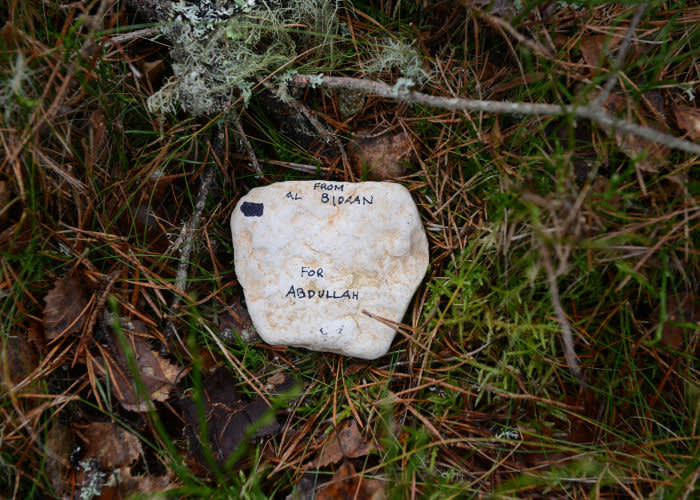 A stone commemorating Abdullah Dilsouz from Afghanistan, run over by a truck en route to Britain