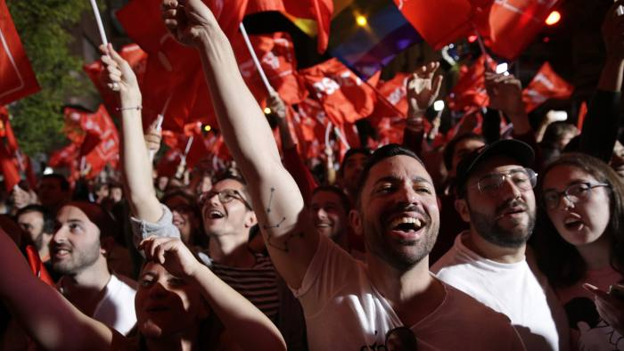 Supporters of Spanish Prime Minister and Socialist Party candidate Pedro Sanchez react as they gather at the party headquarters waiting for results of the general election in Madrid, Sunday, April 28, 2019. A divided Spain voted Sunday in its third general election in four years, with all eyes on whether a far-right party will enter Parliament for the first time in decades and potentially help unseat the Socialist government. (AP Photo/Andrea Comas)