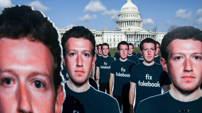 Dozens of cardboard cut-outs of Facebook CEO Mark Zuckerberg sit outside of the U.S. Capitol Building as part of an Avaaz.org protest in Washington, U.S., April 10, 2018. REUTERS/Leah Millis - RC18D3497C00