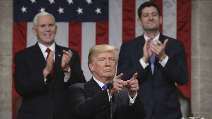 President Donald Trump gestures as delivers his first State of the Union address in the House chamber of the U.S. Capitol to a joint session of Congress Tuesday, Jan. 30, 2018 in Washington, as Vice President Mike Pence and House Speaker Paul Ryan applaud. (Win McNamee/Pool via AP)