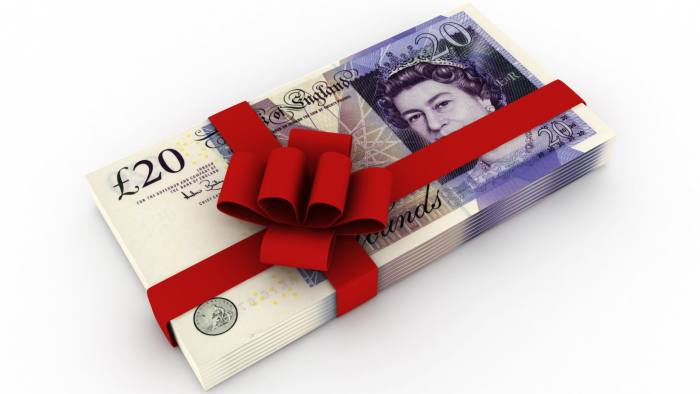 Sterling banknotes wrapped in ribbon