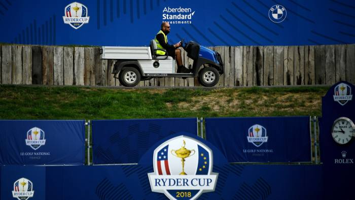 A member of staff drives a buggy past Ryder Cup Logos on September 19, 2018, at Golf National in Guyancourt, near Paris where the biennial men's golf competition, the Ryder Cup will take place in September with Thomas Bjørn set to lead Europe against Jim Furyk's United States. (Photo by FRANCK FIFE / AFP) (Photo credit should read FRANCK FIFE/AFP/Getty Images)