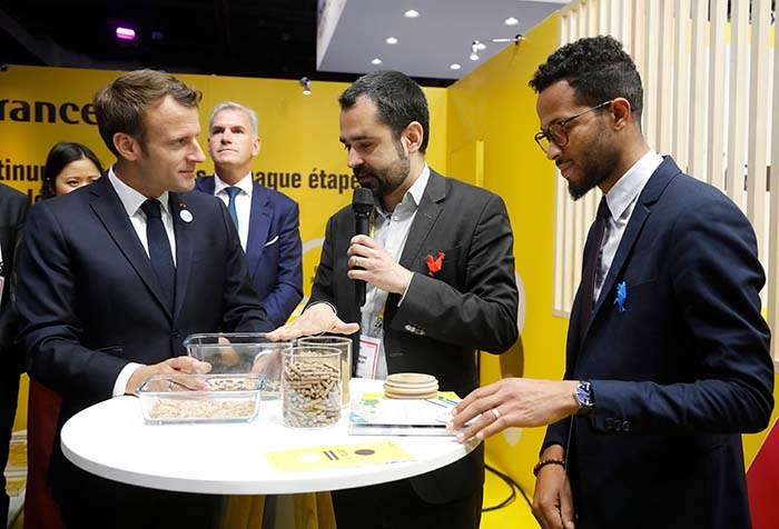 French President Emmanuel Macron (L) listens to CEO of Ynsect Antoine Hubert (C) during a visit to the Vivatech French tech trade show at Paris Expo in Paris on May 16, 2019. (Photo by Michel Euler / POOL / AFP) (Photo credit should read MICHEL EULER/AFP via Getty Images)