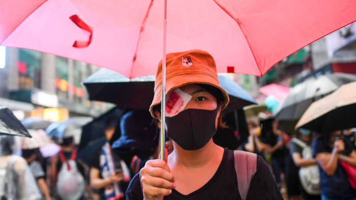 Crowds marched through the streets of Hong Kong in a torrential downpour
