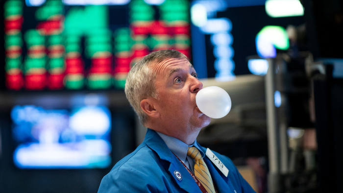 A trader blows bubble gum during the opening bell at the New York Stock Exchange (NYSE) on August 1, 2019, in New York City. - Wall Street stocks bounced on August 1, 2019, winning back some of the losses suffered in the prior session following the Federal Reserve's first interest rate cut in more than a decade. Major indices dropped more than one percent in the wake of the rate decision on July 31, which was followed by a confusing news conference by Fed Chair Jerome Powell who tried to justify the move and explain the implications for monetary policy in coming months. (Photo by Johannes EISELE / AFP) (Photo credit should read JOHANNES EISELE/AFP/Getty Images)