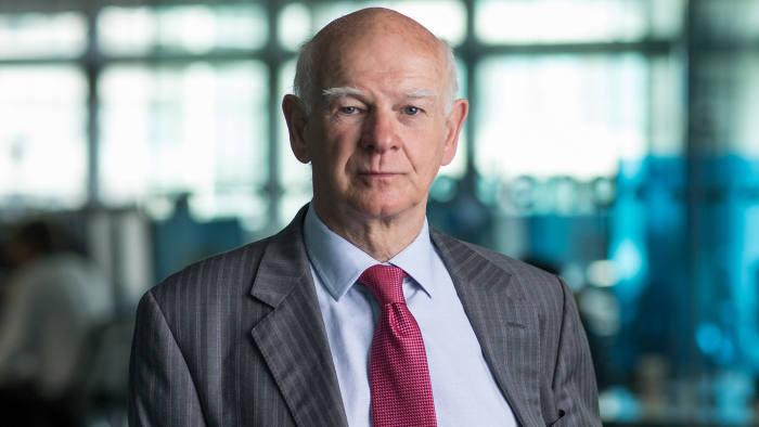 """Howard Davies, chairman of Royal Bank of Scotland NV (RBS), poses for a photograph following a Bloomberg Television interview in London, U.K., on Monday, Aug. 22, 2016. RBS charging negative rates on collateral """"puts us in line with a lot of banks in the big trading areas,"""" Davies said in the interview. Photographer: Jason Alden/Bloomberg"""