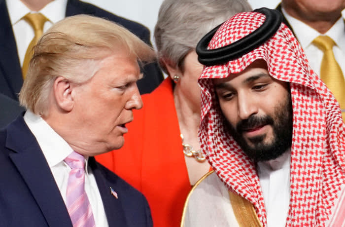 U.S. President Donald Trump speaks with Saudi Arabia's Crown Prince Mohammed bin Salman during family photo session with other leaders and attendees at the G20 leaders summit in Osaka, Japan, June 28, 2019. REUTERS/Kevin Lamarque TPX IMAGES OF THE DAY - RC1A069AC350