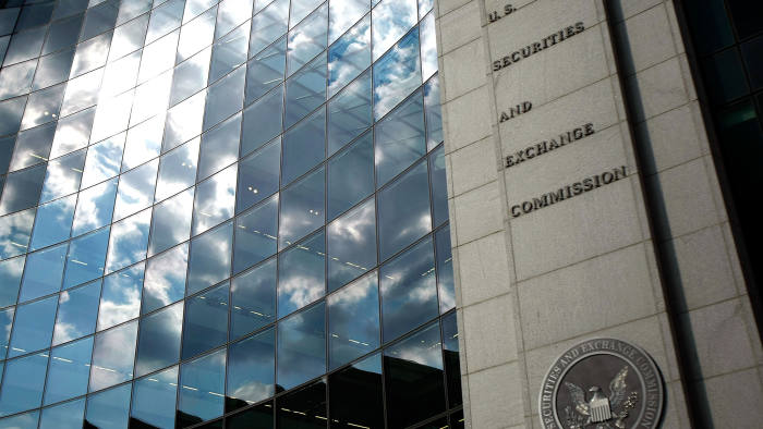 WASHINGTON - SEPTEMBER 18: The U.S. Securities and Exchange Commission seal hangs on the facade of its building September 18, 2008 in Washington, DC. Republican presidential candidate Sen. John McCain (R-AZ) has called for the ouster of SEC Chairman Christopher Cox in the wake of the collapse of several giant banks on Wall Street and the resulting financial crisis. (Photo by Chip Somodevilla/Getty Images)