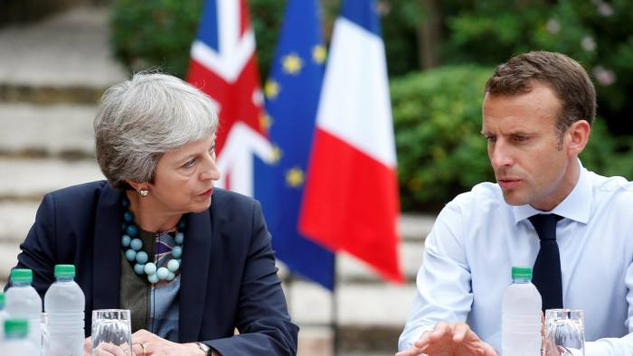 FILE PHOTO: French President Emmanuel Macron meets with British Prime Minister Theresa May at the Fort de Bregancon in Bormes-les-Mimosas, France, August 3, 2018. Sebastien Nogier/Pool via REUTERS/File Photo