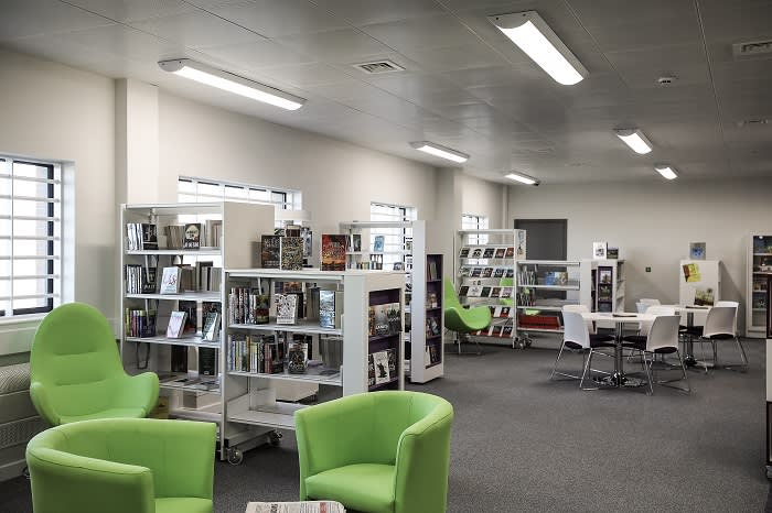 "HMP Berwyn's library. Katie Lomas, national chair of the trade union for probation officers, said HMP Berwyn had a ""really positive aim"" to focus on rehabilitation"