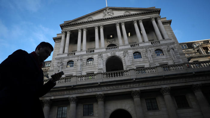 A man walks past the Bank of England in the City of London, Britain, February 7, 2019. REUTERS/Hannah McKay