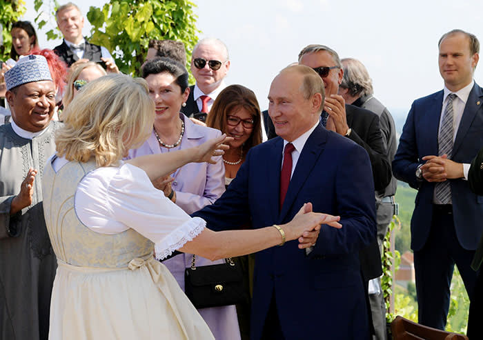 Mandatory Credit: Photo by ALEXEI DRUZHININ/SPUTNIK/KREMLIN POOL/EPA-EFE/REX/Shutterstock (9793609r) Russian President Vladimir Putin (C-R) dances with Austrian Foreign Minister Karin Kneissl (C-L), during her wedding to Austrian businessman Wolfgang Meilinger in Gamlitz, Austria, 18 August 2018. According to reports, Putin attended Kneissl's wedding in the Styrian municipality of Gamlitz on 18 August, before travelling to Meseberg, Germany, where he is to meet with German Chancellor Angela Merkel. Wedding of Austrian Foreign Minister Kneissl, Gamlitz, Austria - 18 Aug 2018