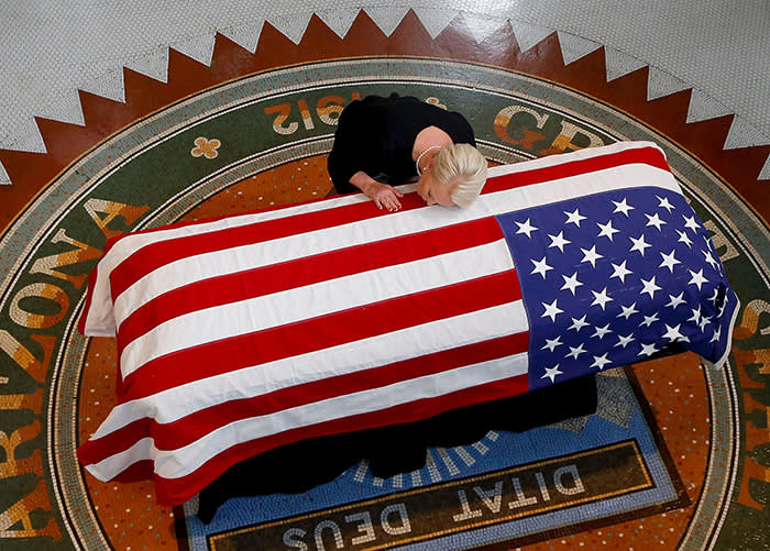 TOPSHOT - Cindy McCain, wife of US Senator John McCain, kisses his casket during a memorial service at the Arizona Capitol on August 29, 2018, in Phoenix. (Photo by Ross D. Franklin / POOL / AFP)ROSS D. FRANKLIN/AFP/Getty Images