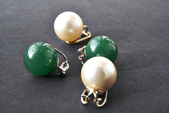 Sandra Choi at Jimmy Choo 10 Howick Place SW1P 1GW London for Financial Times; mismatched vintage green and pearl earrings she likes to wear as a pair,