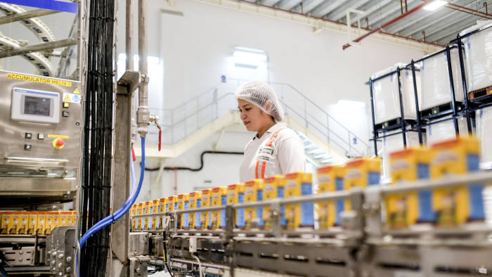 An employee monitors cartons of Chuckie, a Nestle SA chocolate flavored milk drink, moving along a conveyor at the company's factory in Batangas province, the Philippines, on Tuesday, April 2, 2019. Nestle Philippines targets to double production of its chocolate milk brand product with its new 2.8b-peso plant in Batangas province, chairman and CEOKais Marzoukisays. Photographer: Veejay Villafranca/Bloomberg via Getty Images